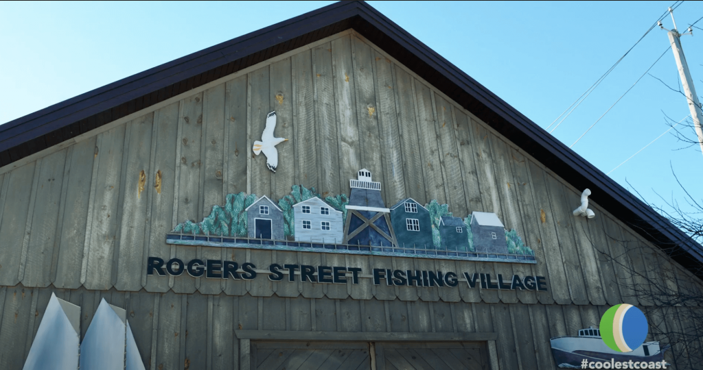 Rogers Street Fishing Village sign on a building